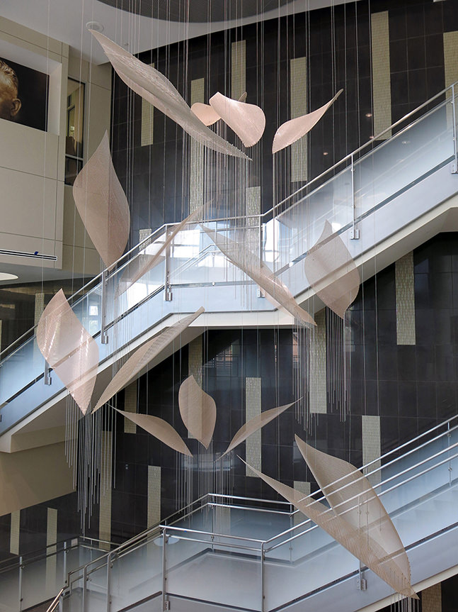 Contrails suspended sculpture art commission above the Ambulatory Care info desk in the atrium.