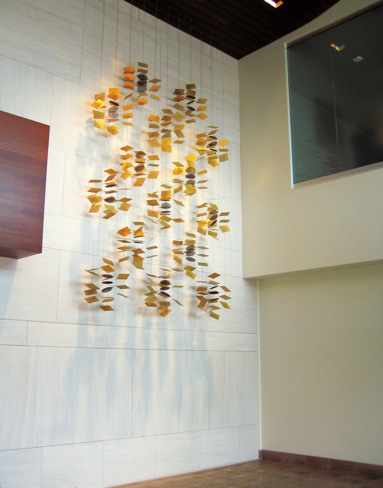 Alhambra Archetype gold corporate art wall sculpture by Talley Fisher.