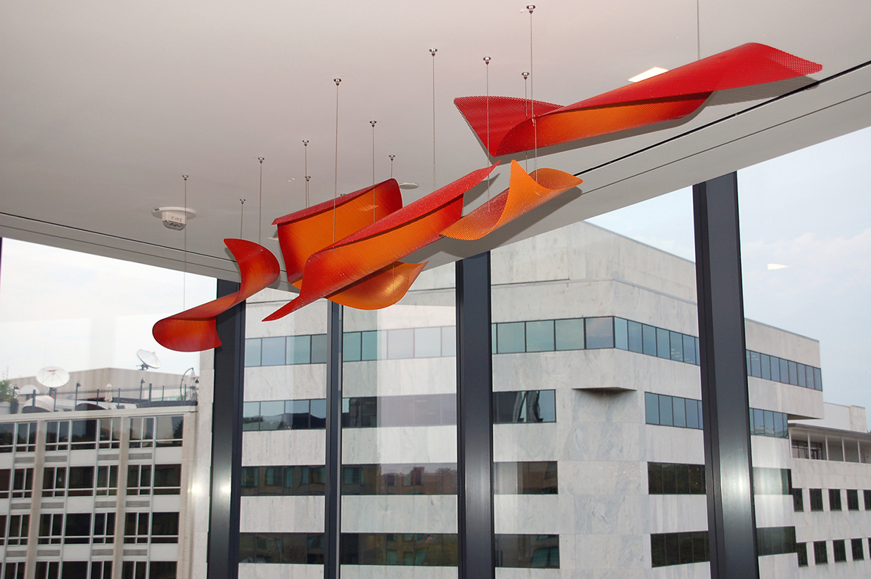 Vibrant suspended sculpture by Talley Fisher in Comcast Corporation Headquarters