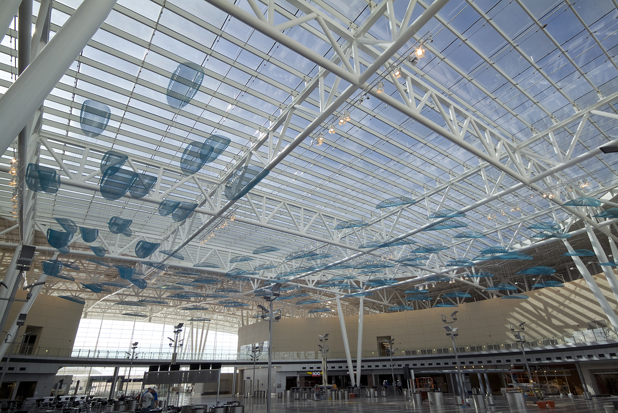 JetStream suspended sculpture by Talley and Rob Fisher in the distance in Indianapolis International Airport