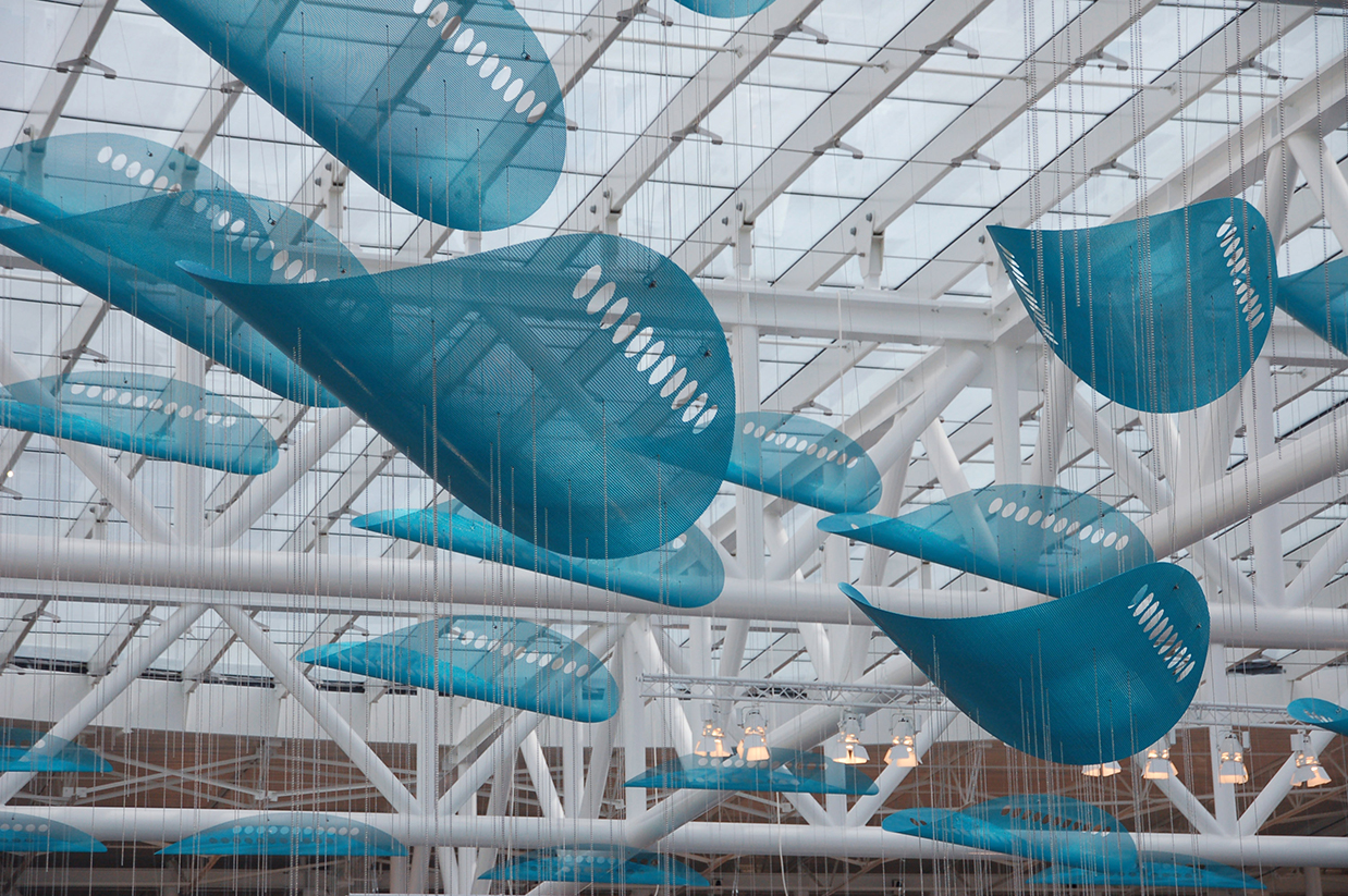 Large blue elements of JetStream, suspended sculpture by Talley and Rob Fisher in Indianapolis International Airport