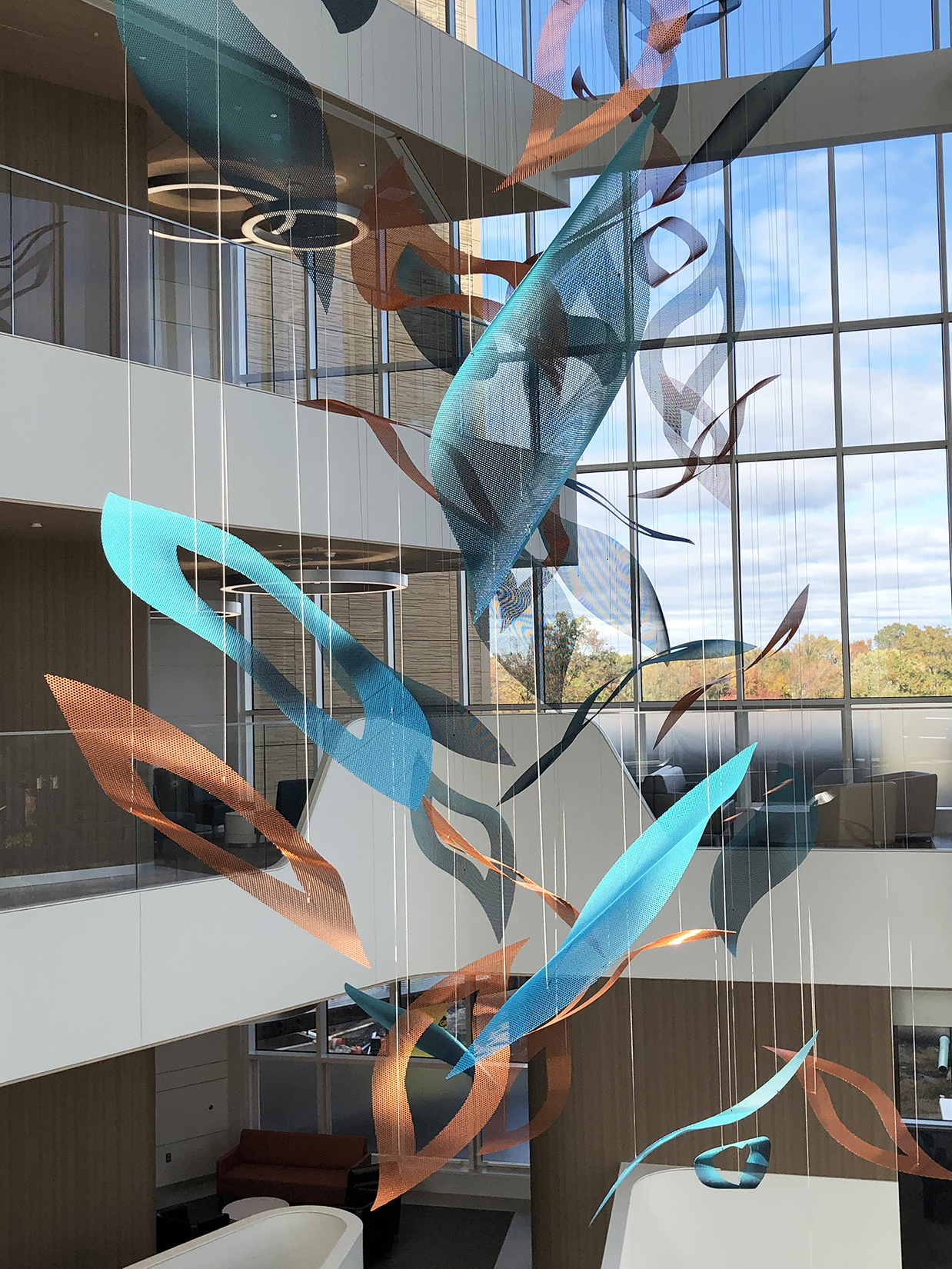 Bright blue and copper petals catch the light in Talley Fisher's Nature's Symphony atrium sculpture.