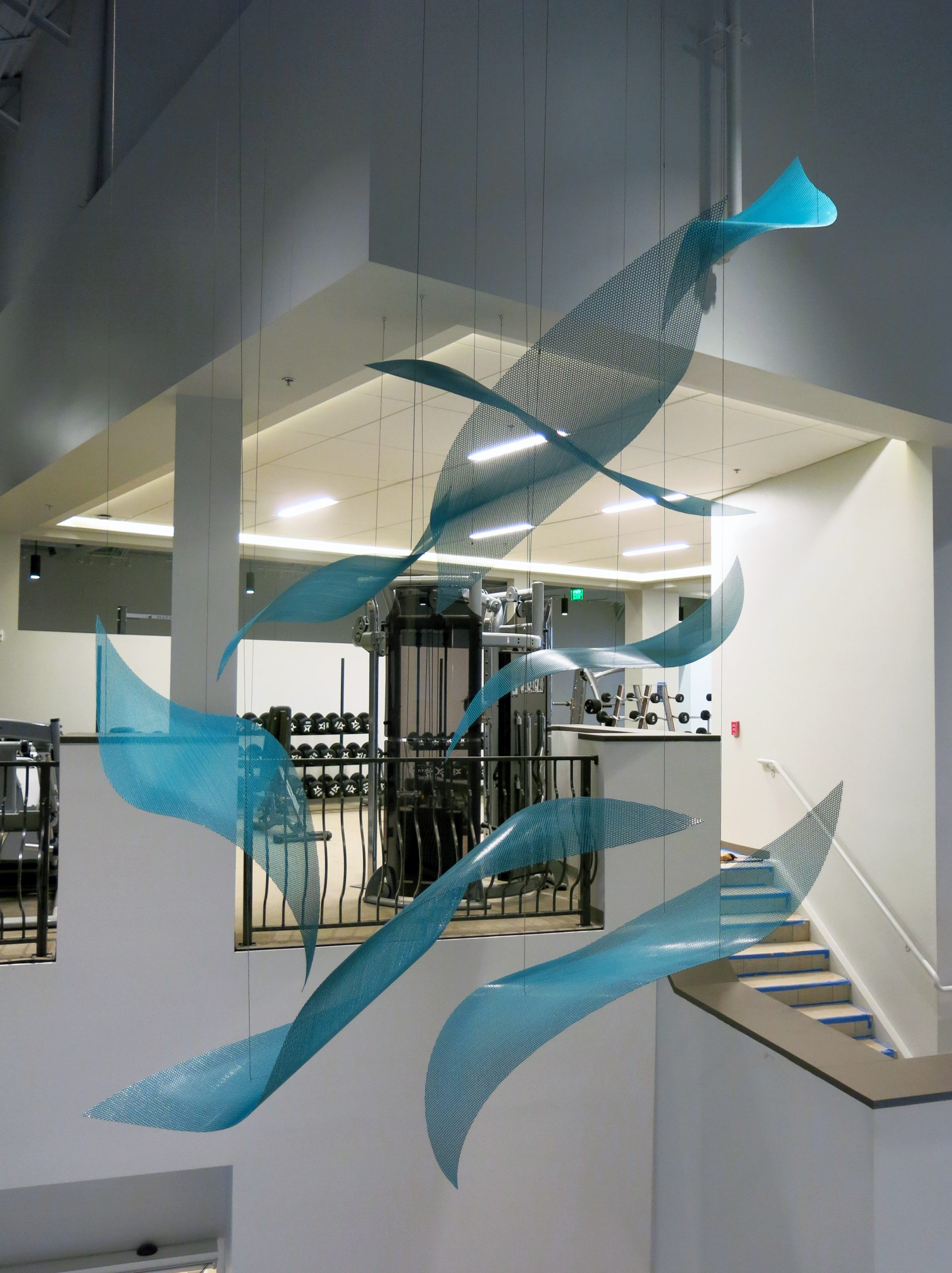 Suspended sculpture by Talley Fisher in the lobby of Aurora Health and Wellness Center.