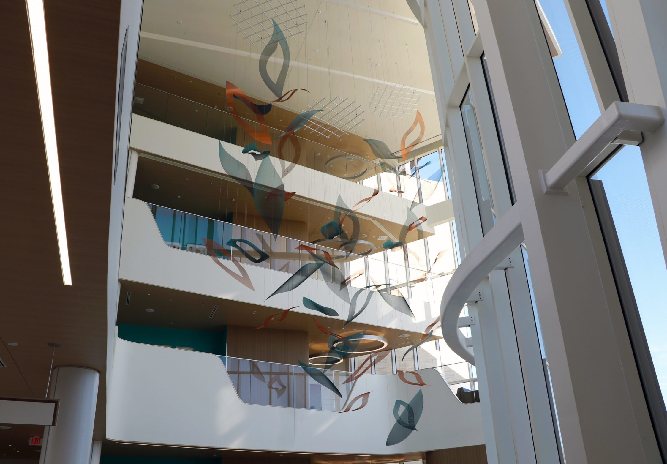 Talley Fisher's atrium sculpture, Nature's Symphony, as seen from the lobby area.