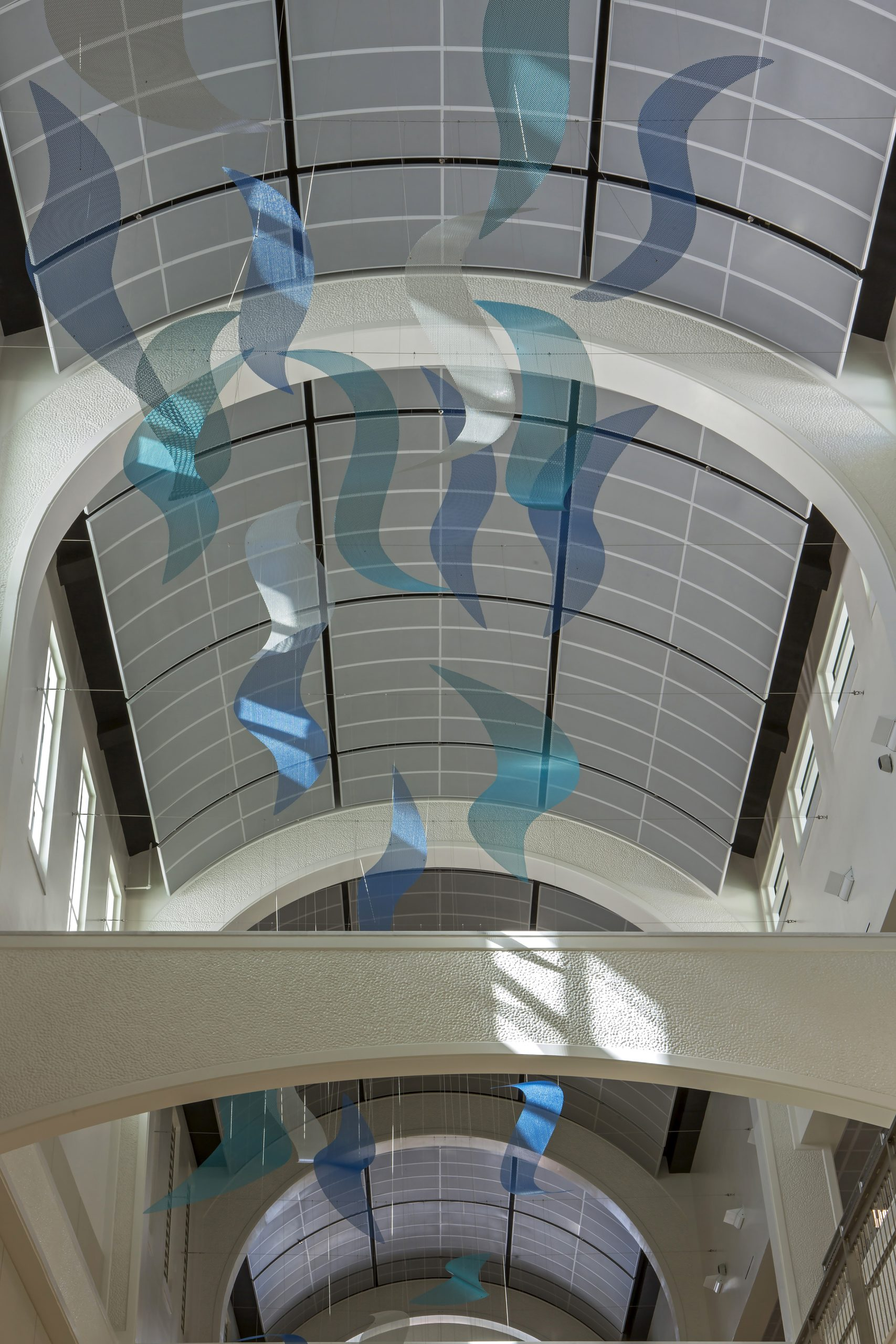 Sunlight hitting wave elements of Talley Fisher's Sea Change in US Naval Hospital, Guam.