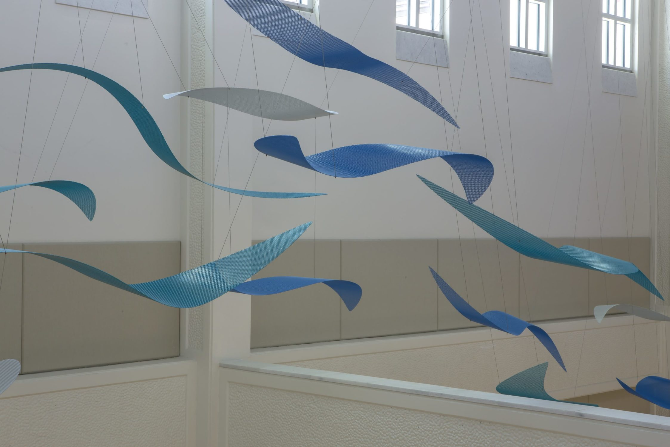 Blue and white wave elements from Talley Fisher's Sea Change in US Naval Hospital, Guam