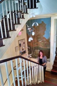 Artist Talley Fisher with her suspended sculpture, See-Scape, Bellefonte Art Museum