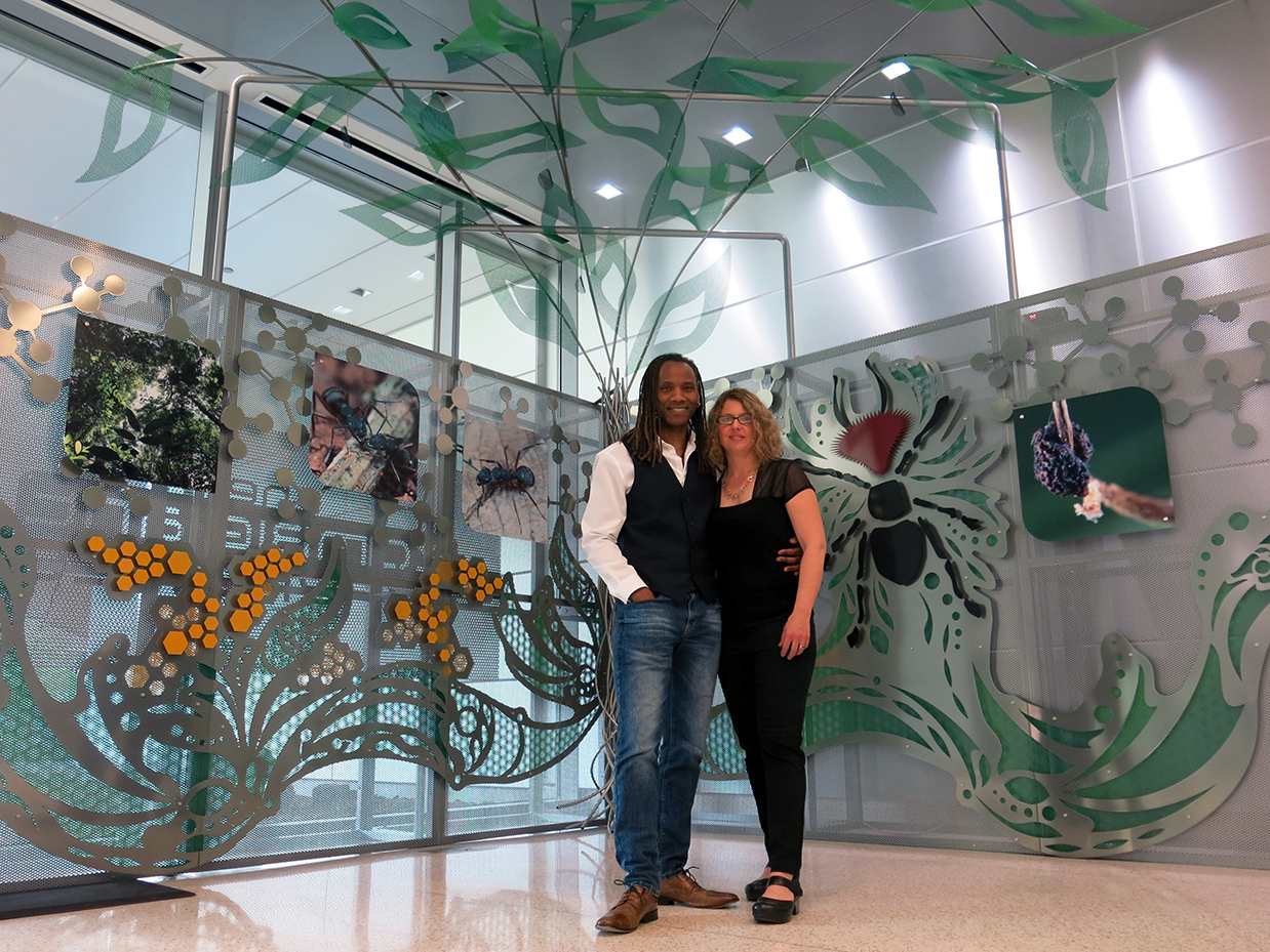 Lead Daryl Branford and Talley Fisher in front of The Zombie Ant Experience interactive sculpture at Penn State Huck Institute of Life Sciences