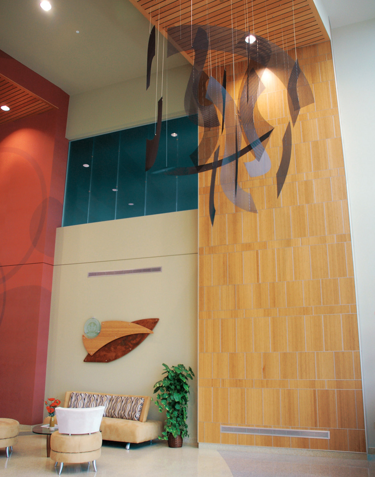 Transformation corporate art sculpture by Talley Fisher above the lobby in Gialamas Group: Erdman Building