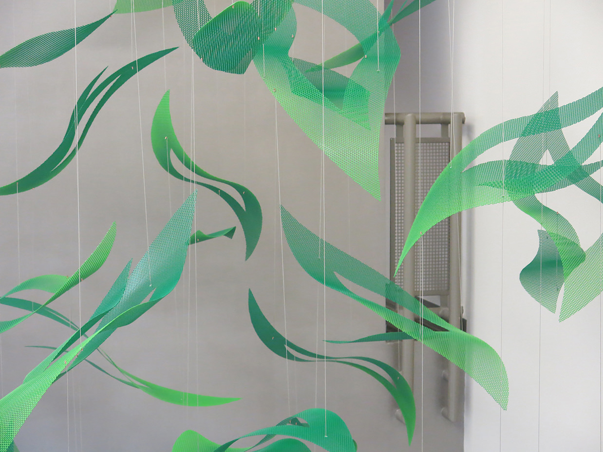 Vibrant green petals of Talley Fisher's Emerald Cascade lobby art.