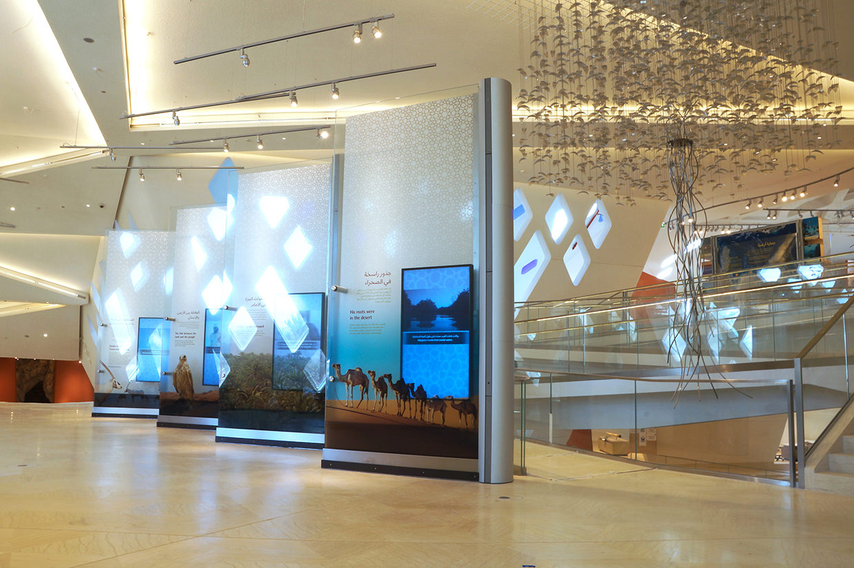Talley Fisher's international art piece, Ghaf Tree, hangs in a modern atrium.