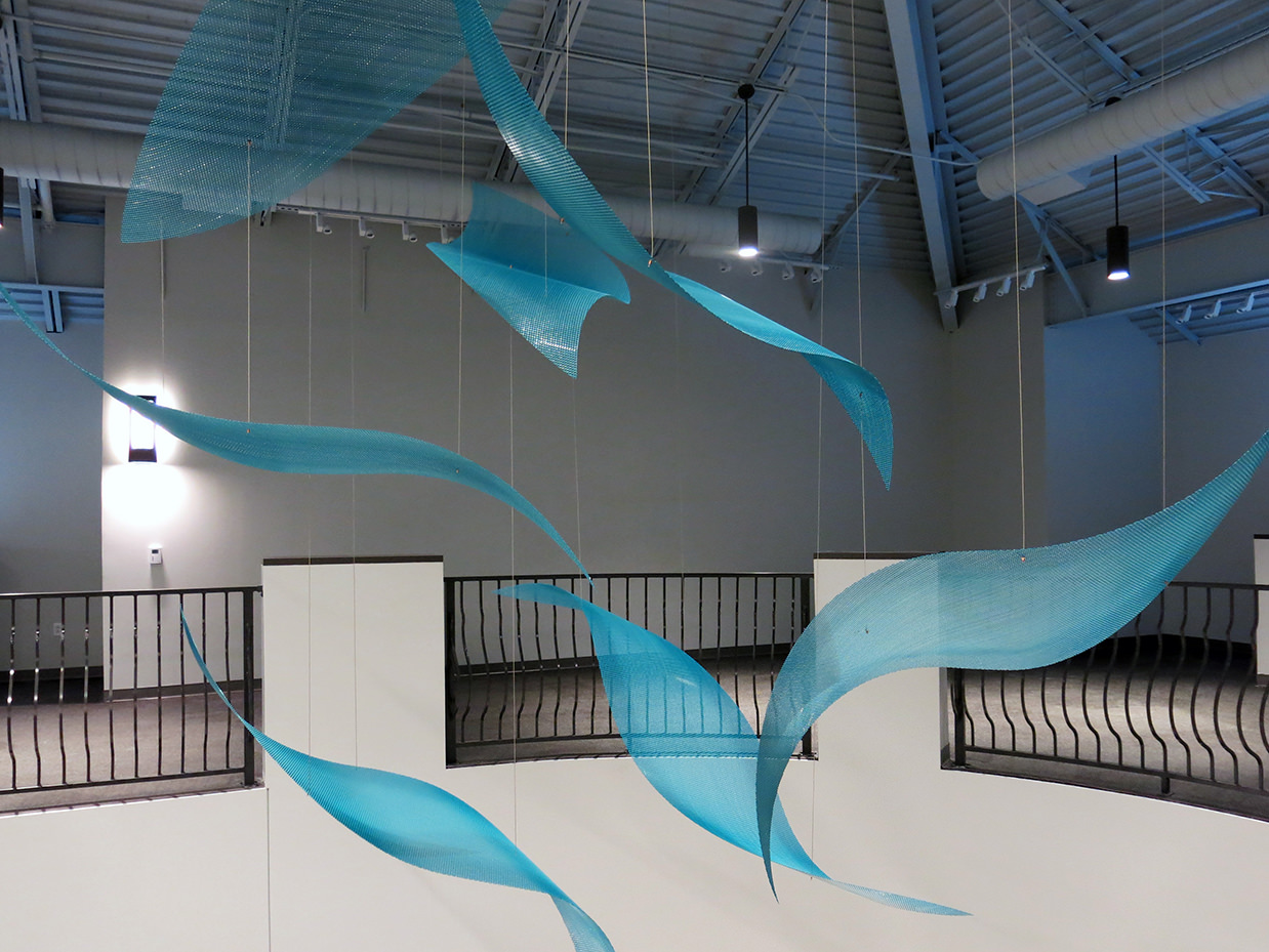 Suspended sculpture by Talley Fisher in the Aurora Health and Wellness Center.