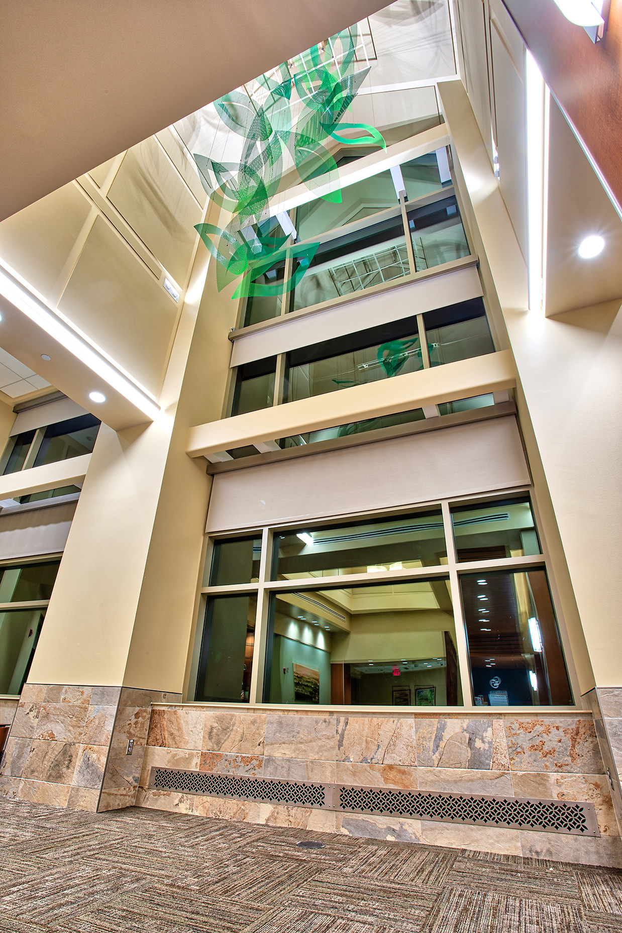Spring suspended sculpture by Talley Fisher in an atrium in Riverside Regional Medical Center