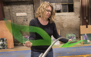 Talley Fisher works on the interactive sculpture, Zombie And Experience, in her studio.