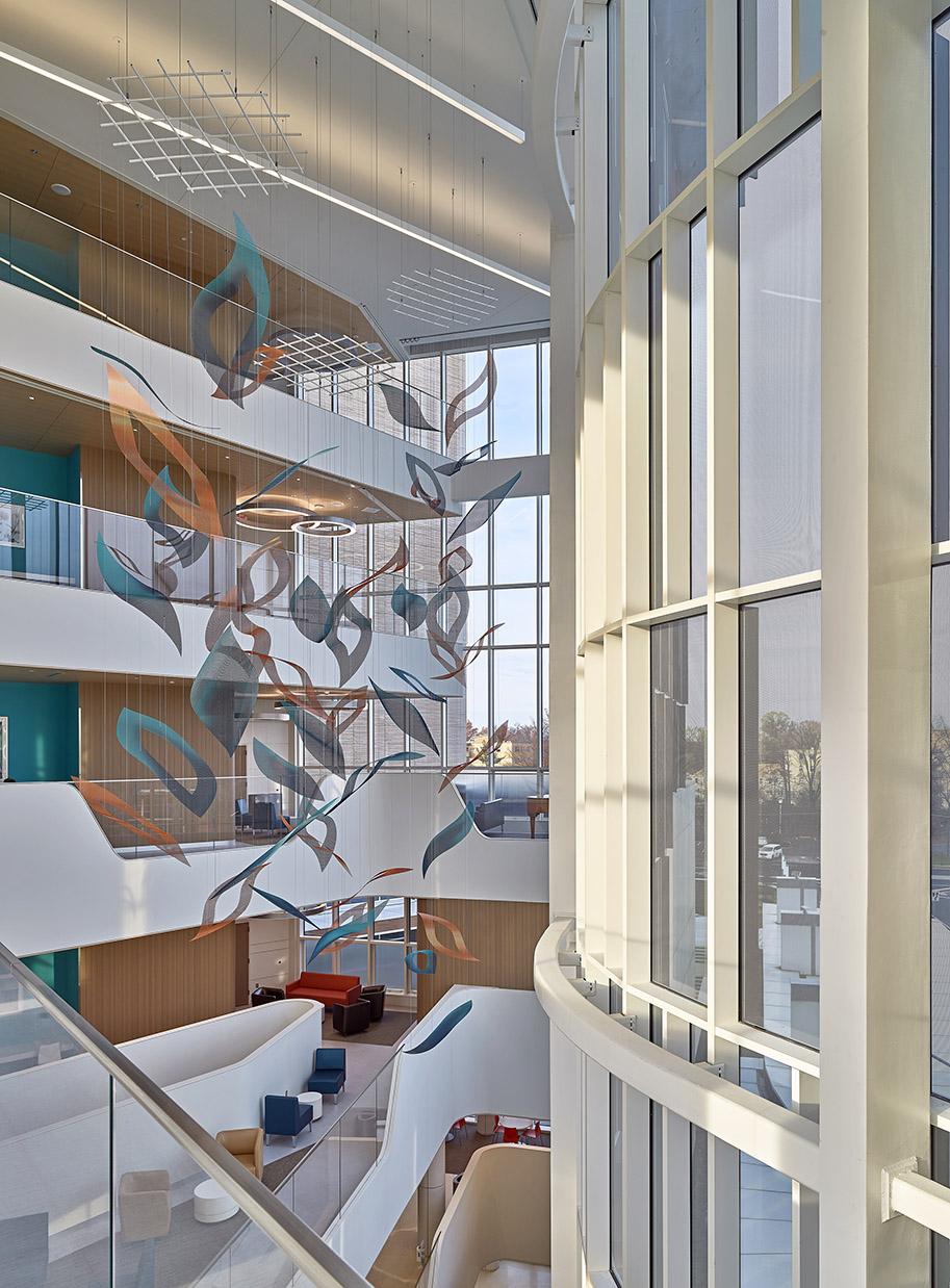 Talley Fisher's Nature's Symphony suspended atrium sculpture in Jefferson Health atrium.