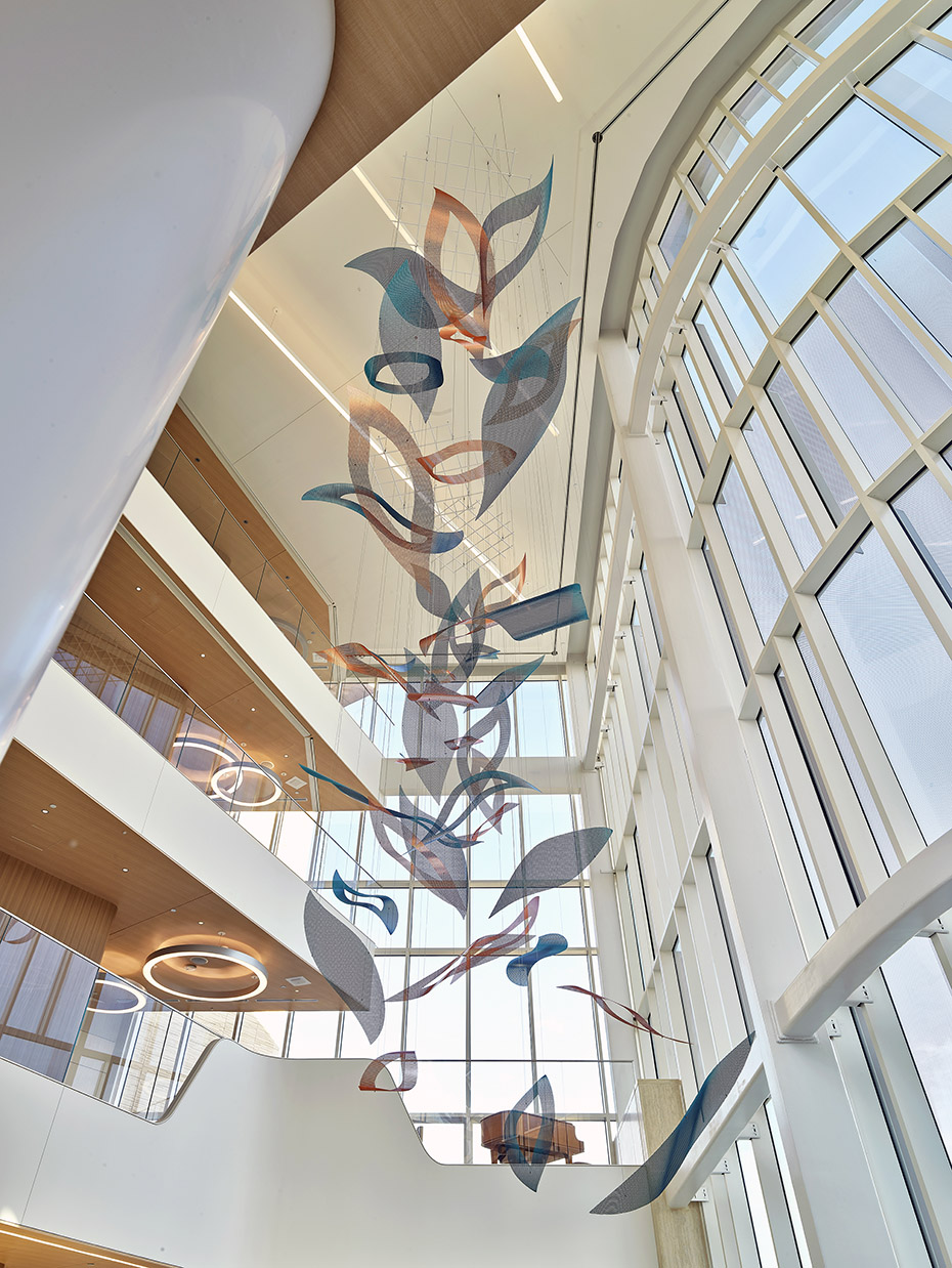 Nature's Symphony suspended sculpture as seen from the lower level of the atrium.