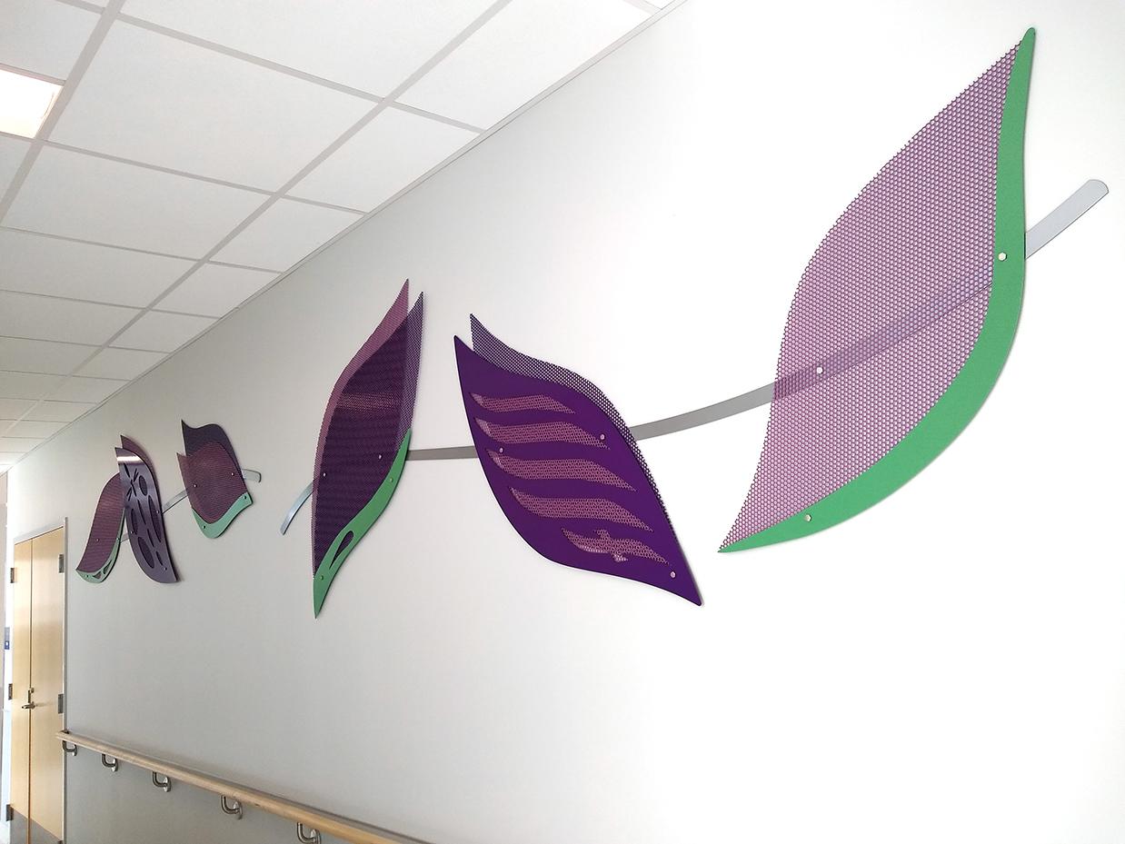 Purple botanical petals of the Hershey emergency department sculpture.